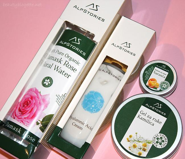 AlpStories Krema s hijaluronskom kiselinom, 100% organska cvjetna voda damask ruže, Melem za usne - Slatka Naranča i Gel za ruke - Kamilica