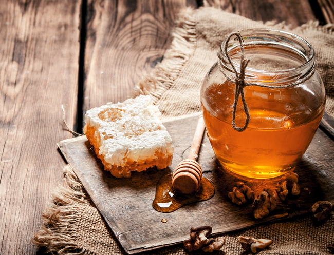 Honey in glass jar from Shutterstock