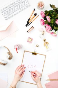 The female hands writing against fashion woman objects from Shutterstock